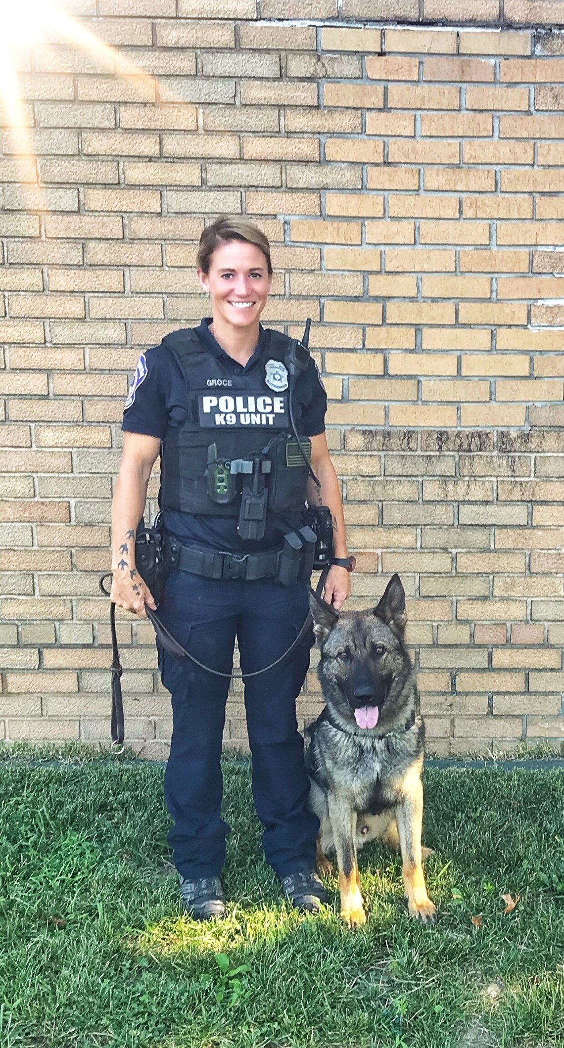 IMPD Officer Molly Groce poses with her second K-9 partner, who she calls Lando, in a 2019 photo shared by the police department.