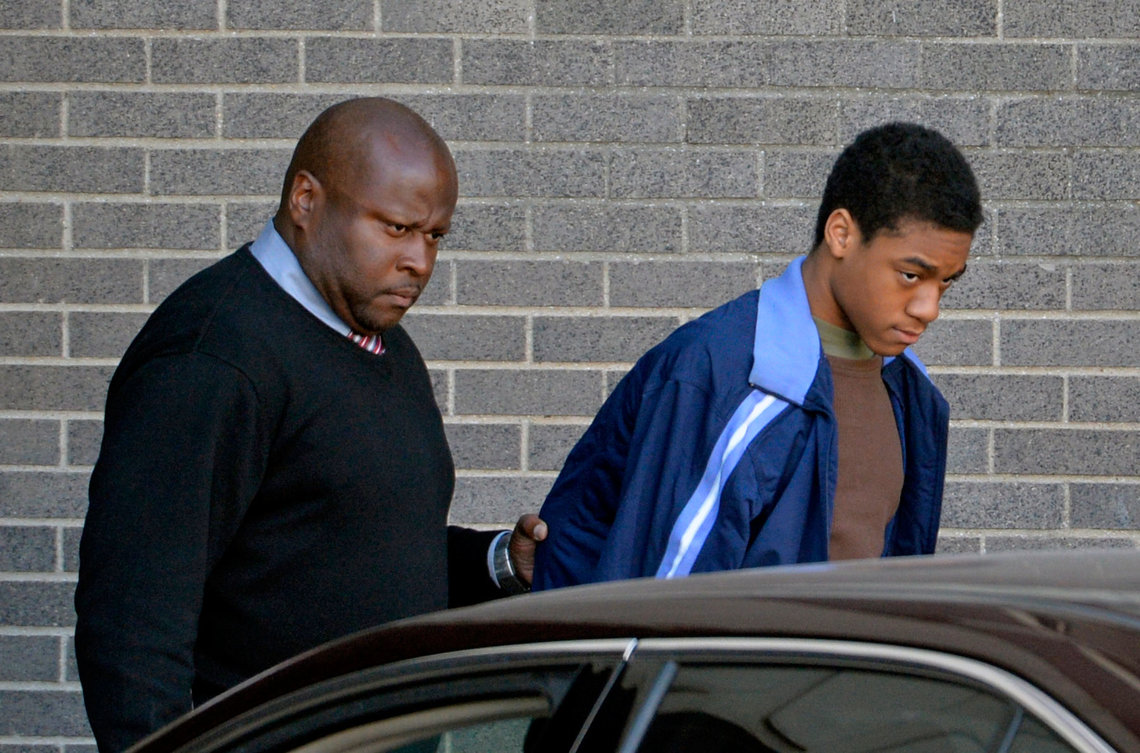 Anderson being escorted to his arraignment on March 21, 2014.
