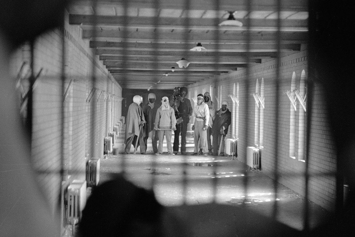 Prisoners at Attica have long complained about being brutalized by corrections officers. During the 1971 uprising, inmates wearing cloaks and football helmets, some of them with makeshift weapons, waited to negotiate their demands with state officials.