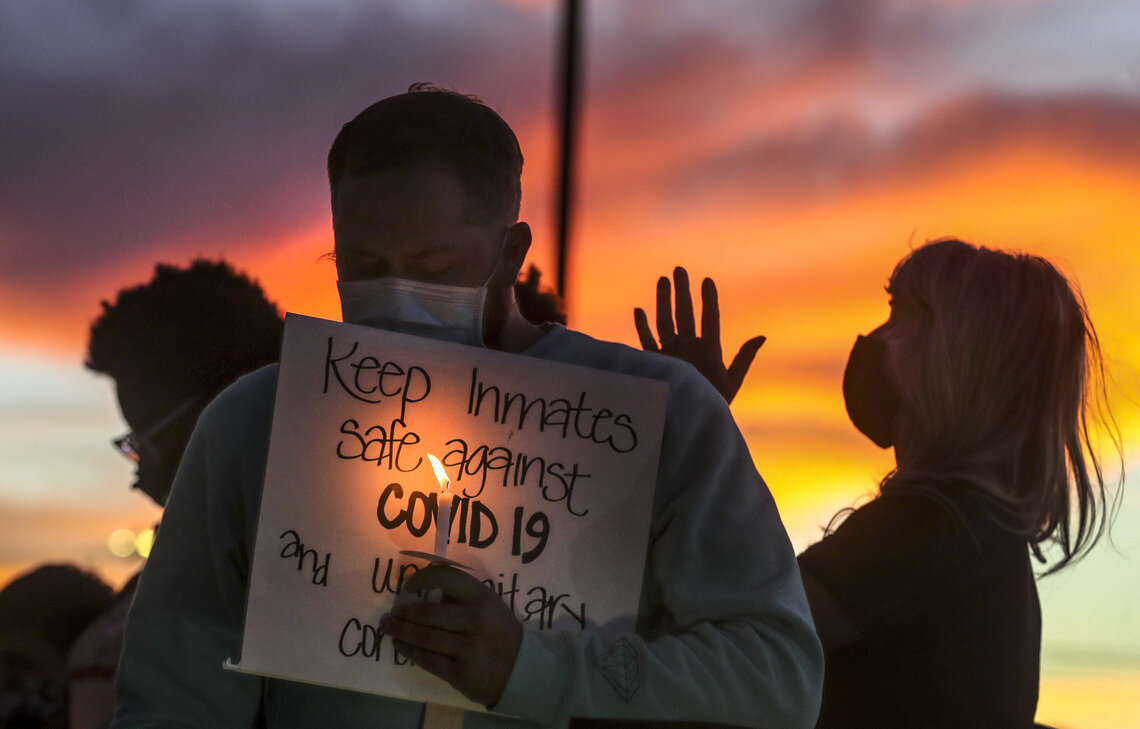 Family members of people incarcerated in Utah prisons held a vigil outside the state Department of Corrections office.