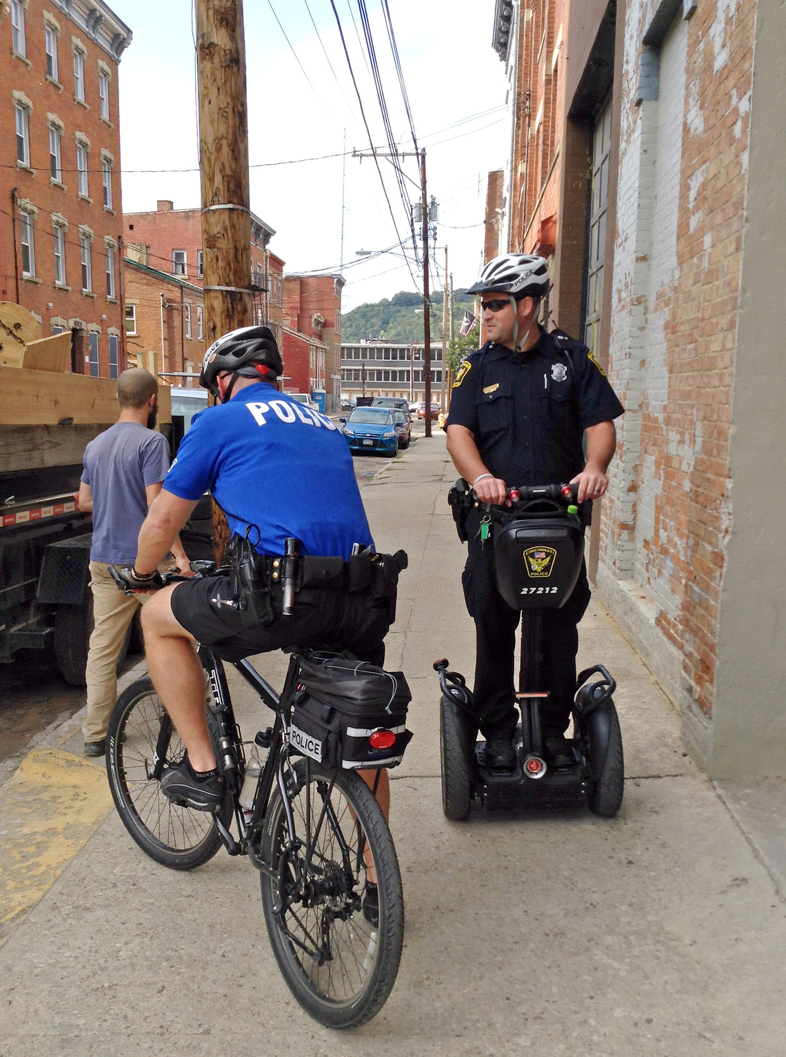 Police officers in Over-the-Rhine out on bike and Segway patrol.