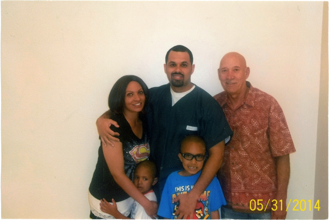 Jasmine, Josiah, Justus, and Lima-Marin's father, Eliseo, right, during a prison visit in 2014.