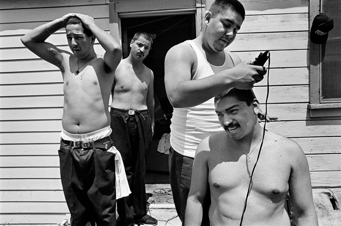 Members of the Evergreen gang give each other haircuts. (Los Angeles, 1993)