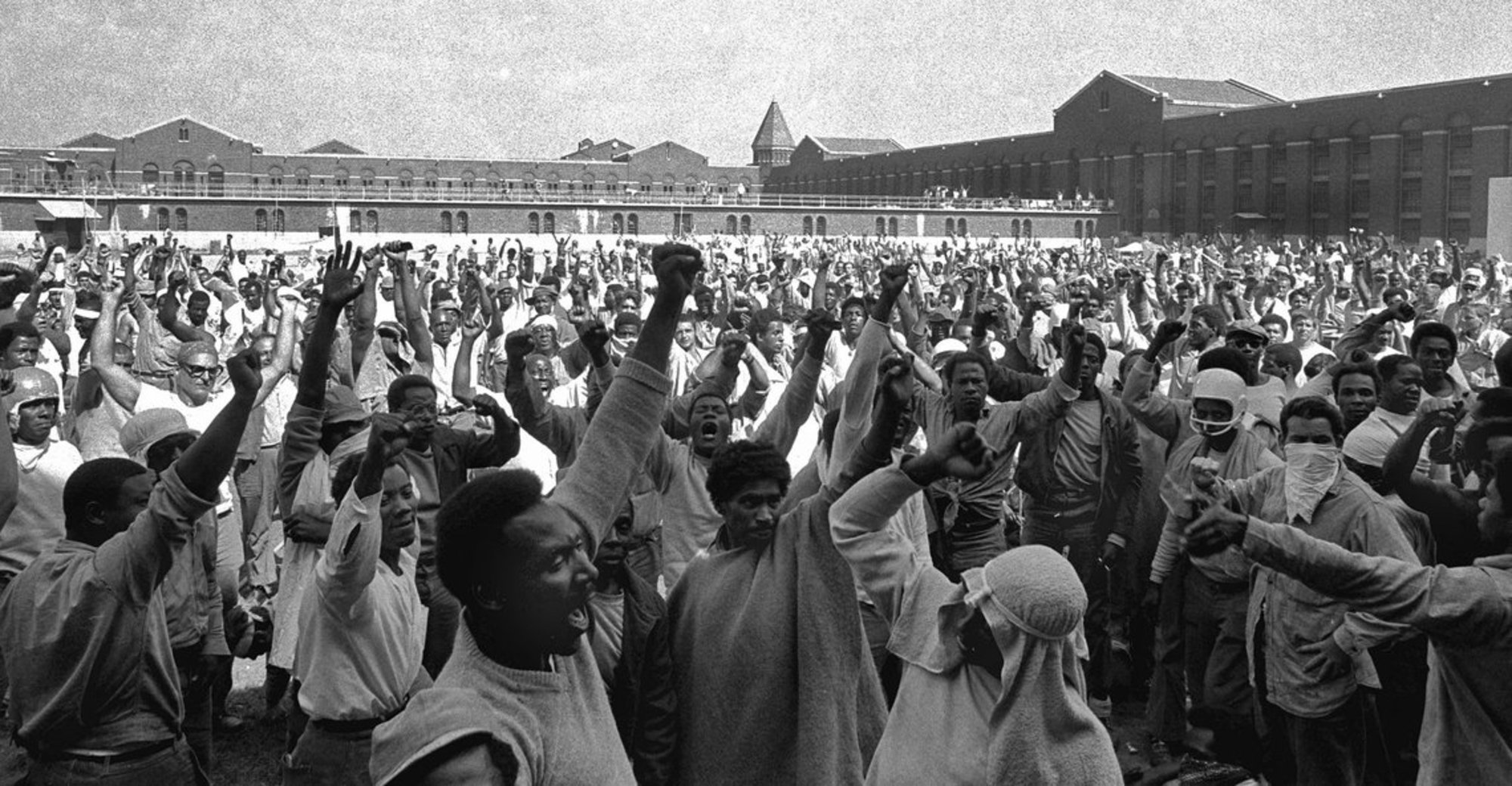 Inmates at Attica shouted their demands during a negotiating session with state corrections officials in September 1971.