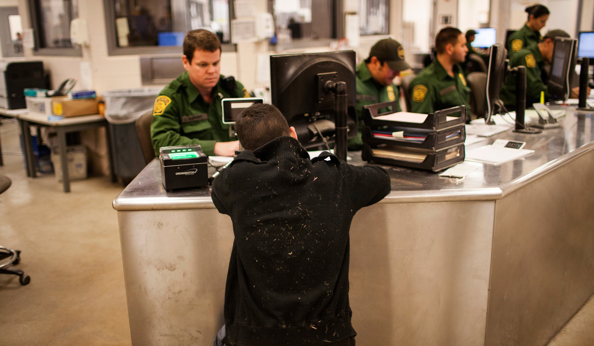 An unaccompanied boy from Guatemala is processed at the Customs and Border Protection Rio Grande Valley sector headquarters in Texas, in 2013.