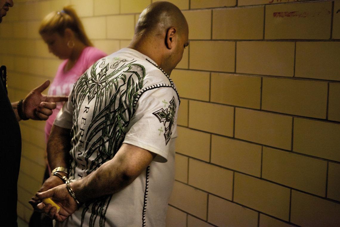 A defendant getting re-arrested in Harlem.