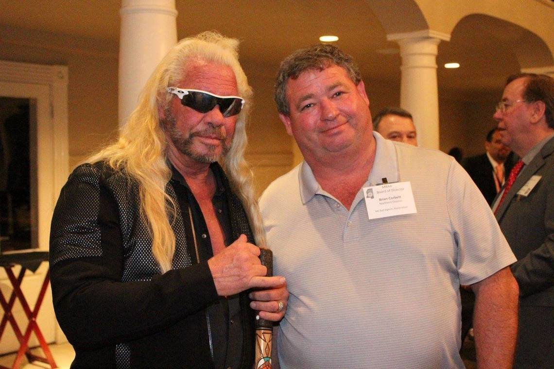 Brian Corbett, right, with Dog the Bounty Hunter at the Mississippi Bail Agents Association's 2017 legislative reception.