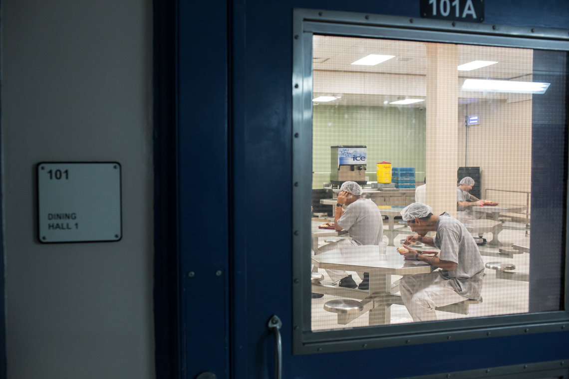Inmates eat at a cafeteria in Central Prison.