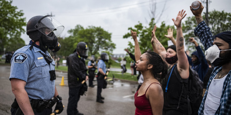 Image of police and protesters