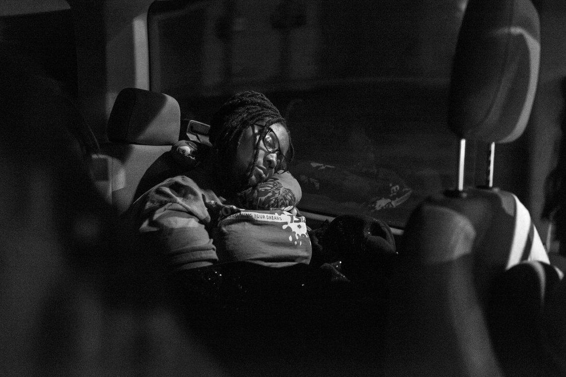 Sabrina Turner sleeps on the over night trip to Wise County, Va.