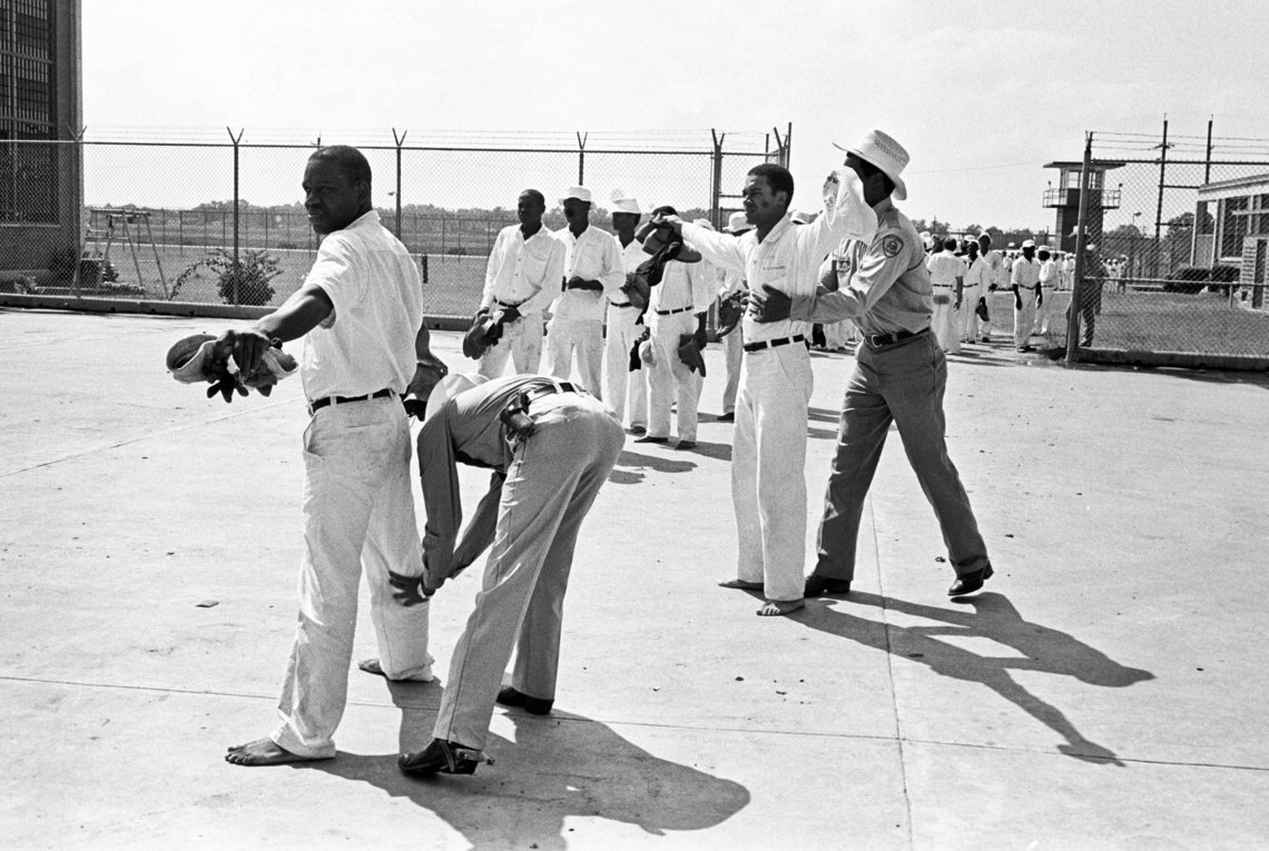 Correctional officers searched prisoners at the Darrington Unit in Rosharon, Texas, after they returned from working in the fields, in 1978. The unit was named after slaveholder John Darrington, who once owned a plantation on that same land.