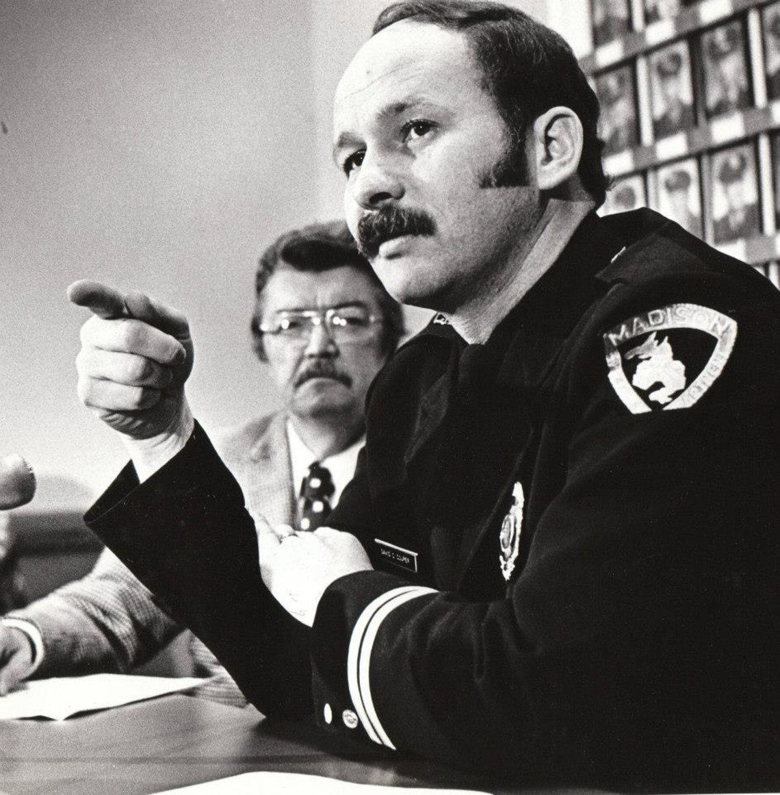David C. Couper, right, in an undated photograph, during his tenure as chief of police.