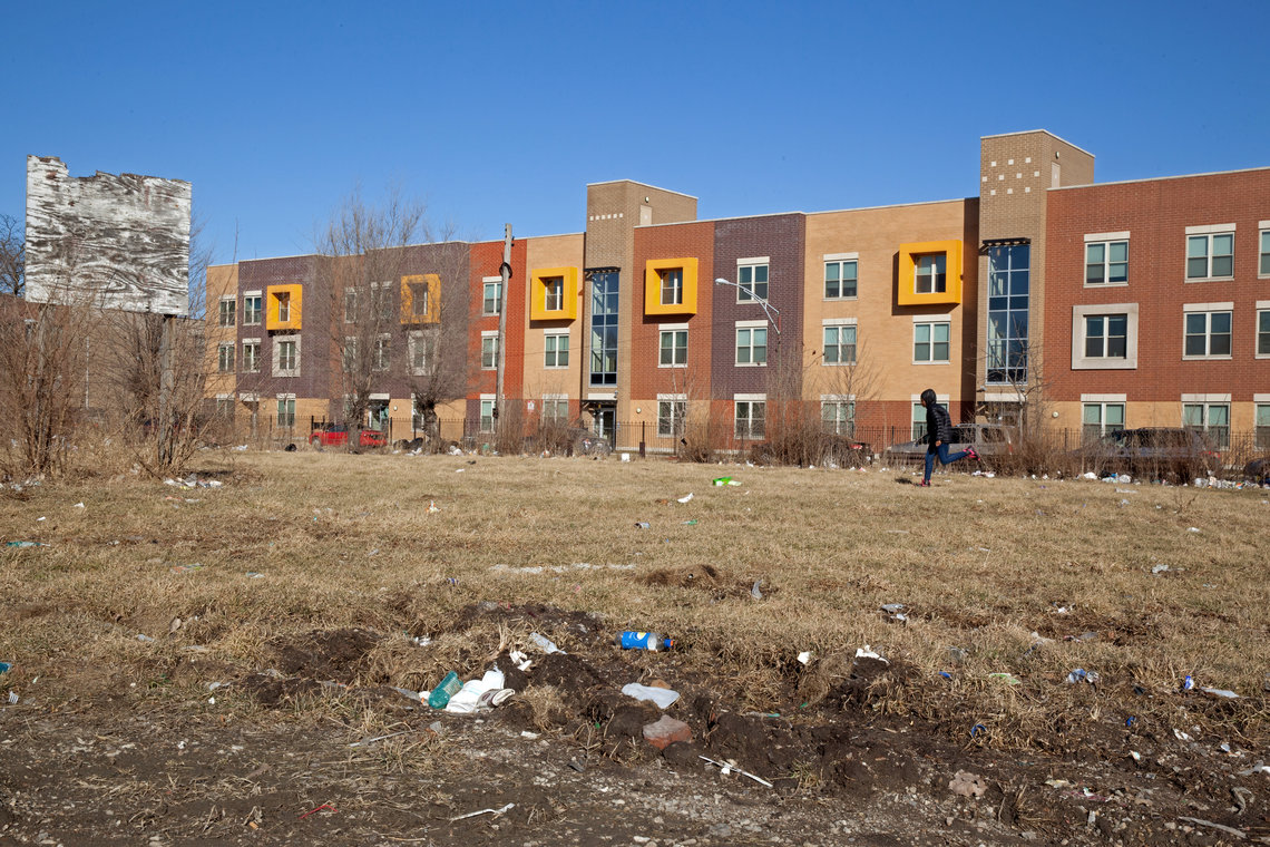 A child runs through an empty lot behind the Dr. King Legacy Apartments in the North Lawndale neighborhood of Chicago in February.