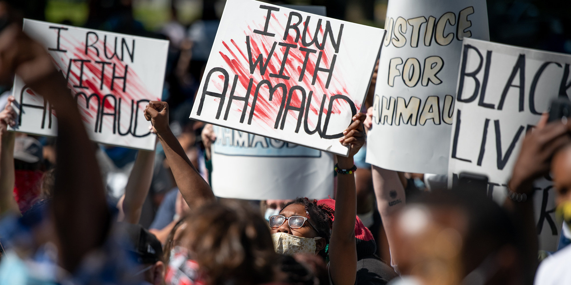 Demonstrators protest the shooting death of Ahmaud Arbery at the Glynn County Courthouse in Brunswick, Georgia, on May 8. Gregory and Travis McMichael were arrested the previous night and charged with murder.