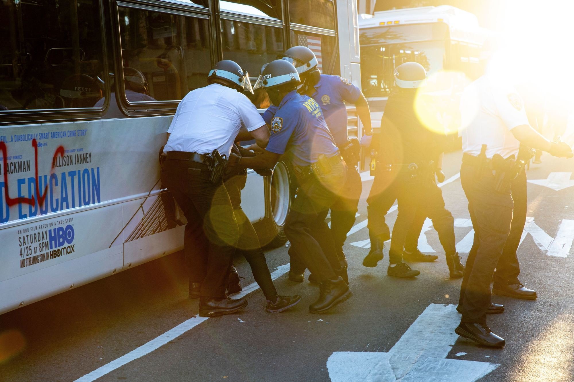 """Police arrest two women for spray painting a local bus in downtown Brooklyn with the acronym FTP (""""Fuck the Police""""). They had started writing """"No Poli…"""" when officers grabbed them, knocking them to the ground."""