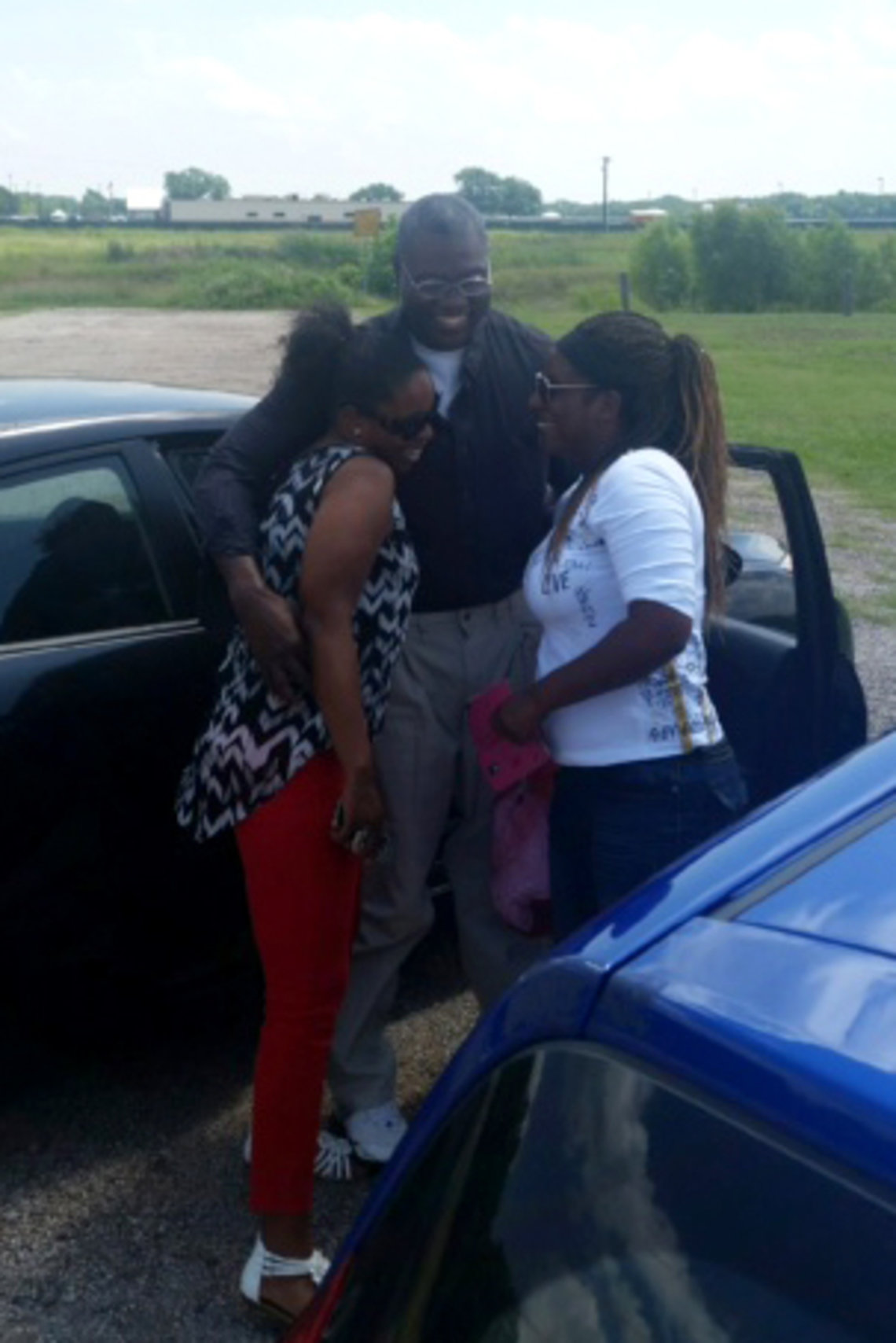 Jerry Hartfield reunites with his nieces Sadora Hickmon, left, and Nana Hartfield, right, after being released from Hutchins State Jail in Dallas in June.