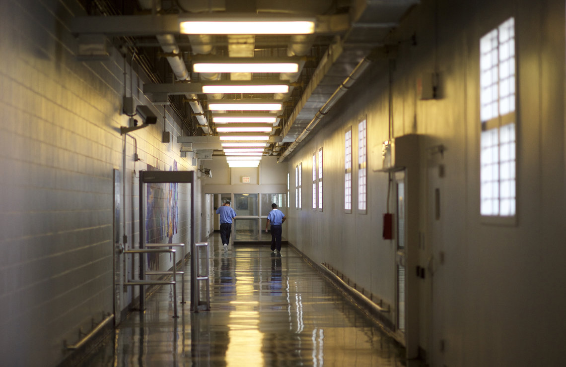 Inmates walk the hallways of the Curran-Fromhold Correctional Facility in Philadelphia, Pa.