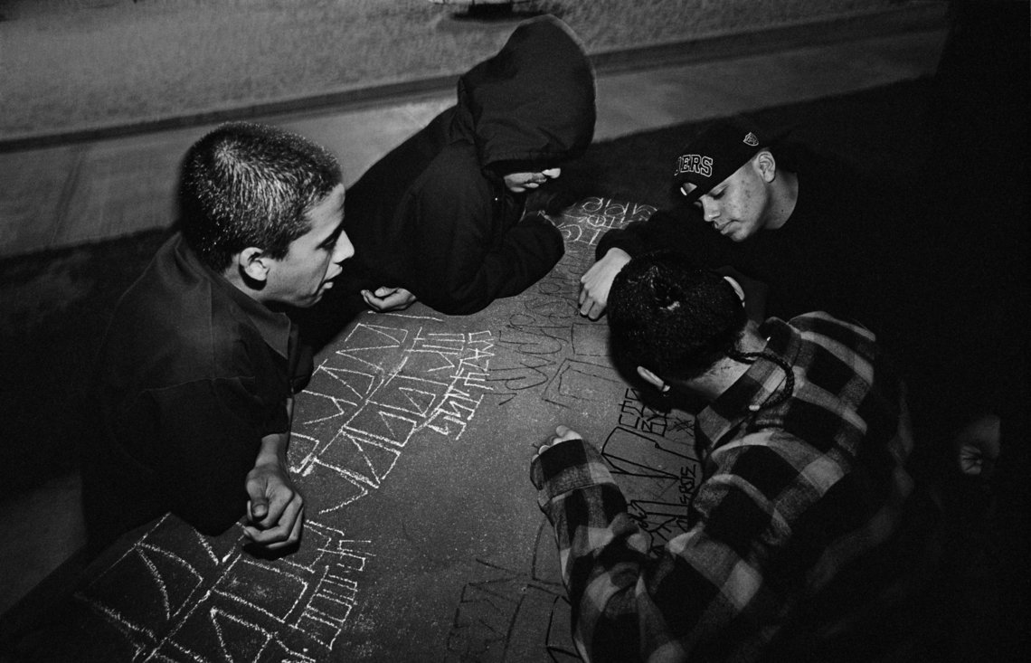 Members of the Evergreen gang marking their territory.  (Los Angeles, 1993)