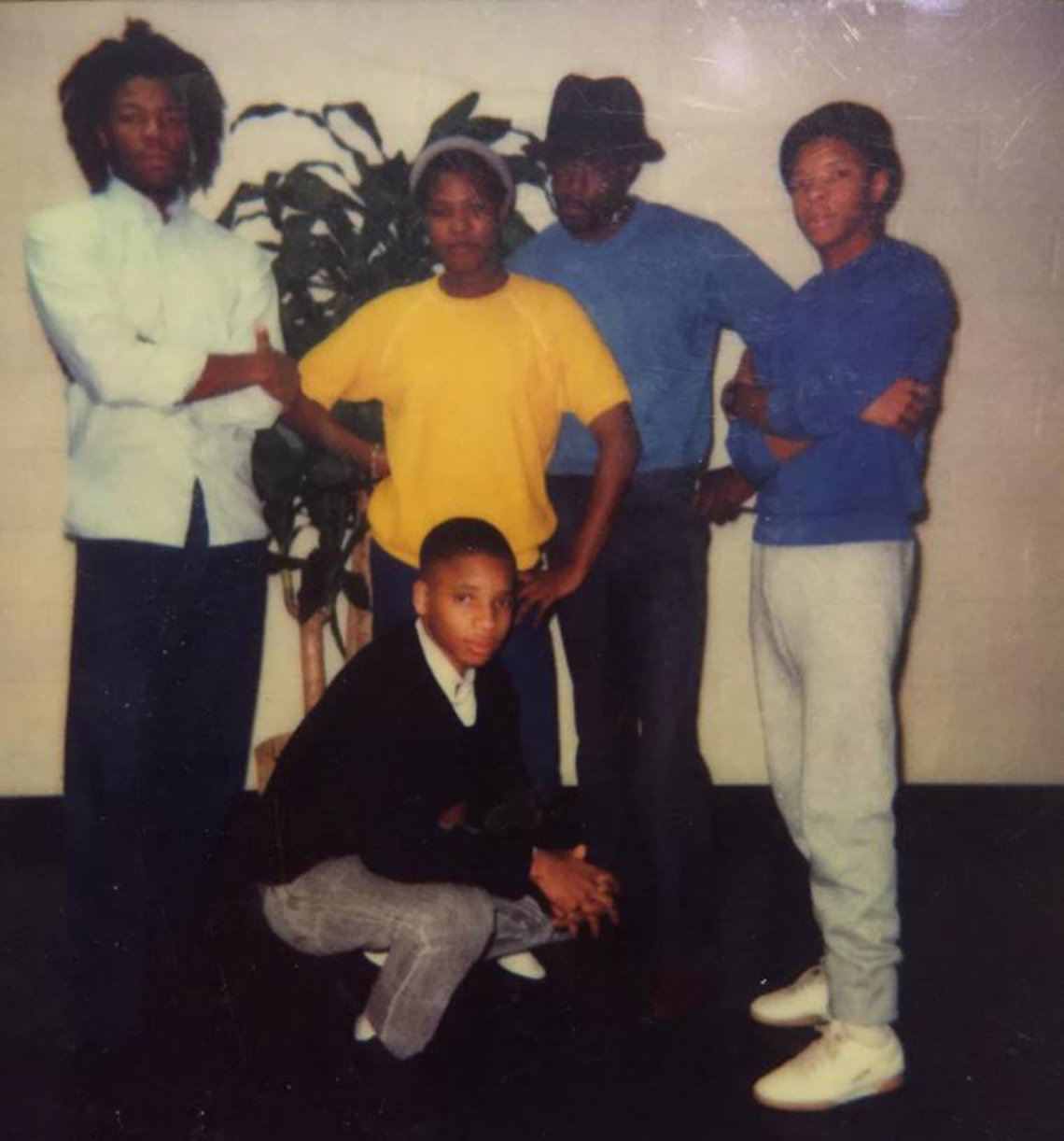 An undated photo taken during a prison visit. Moochie (left) with brothers Willie (front) and Douglas (right), cousin Sharon Reid, and an unidentified friend.