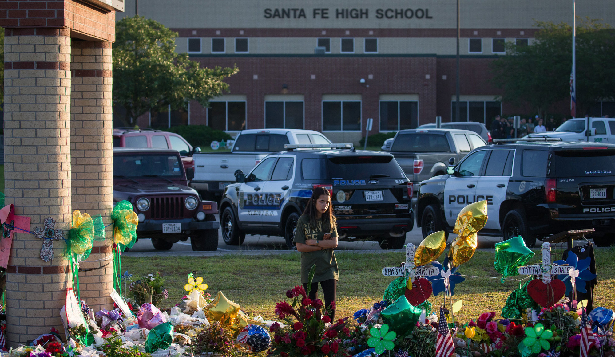 People left flowers at a memorial to shooting victims outside Santa Fe High School, in Santa Fe, Texas, in May.