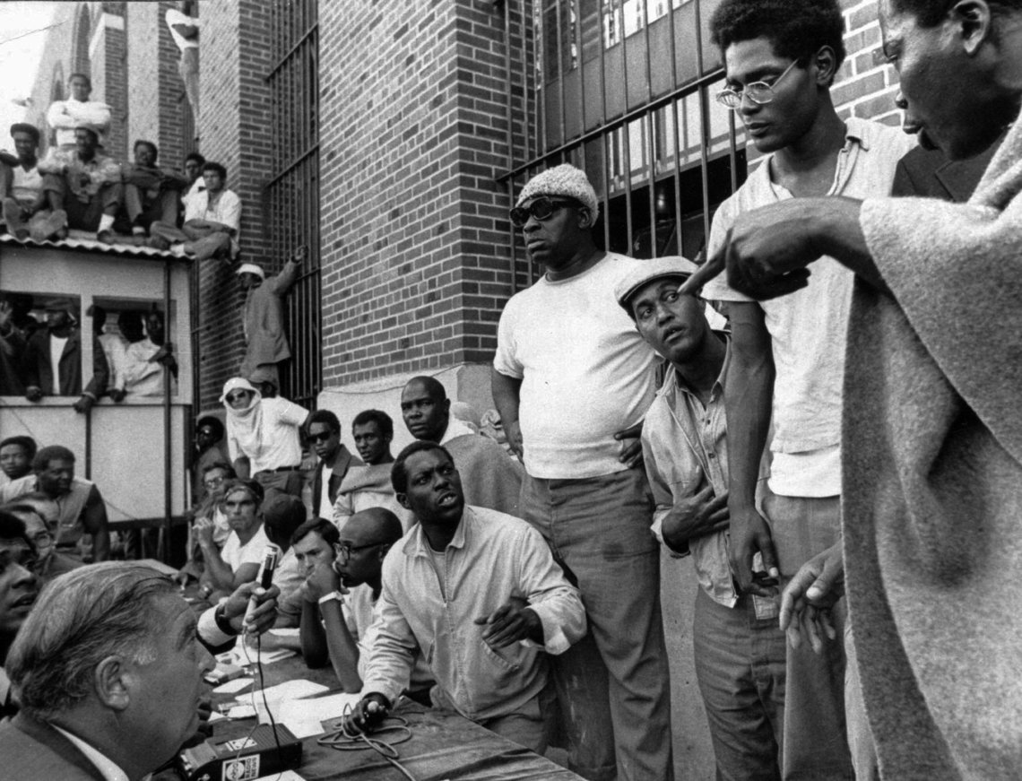Inmates of the Attica Correctional Facility negotiating with Russell G. Oswald, lower left, the state prisons commissioner, in September 1971.