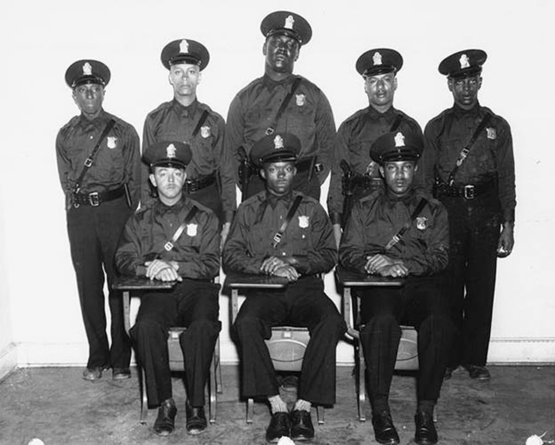 Turner keeps a group portrait of Atlanta's first African-American police officers in his office.