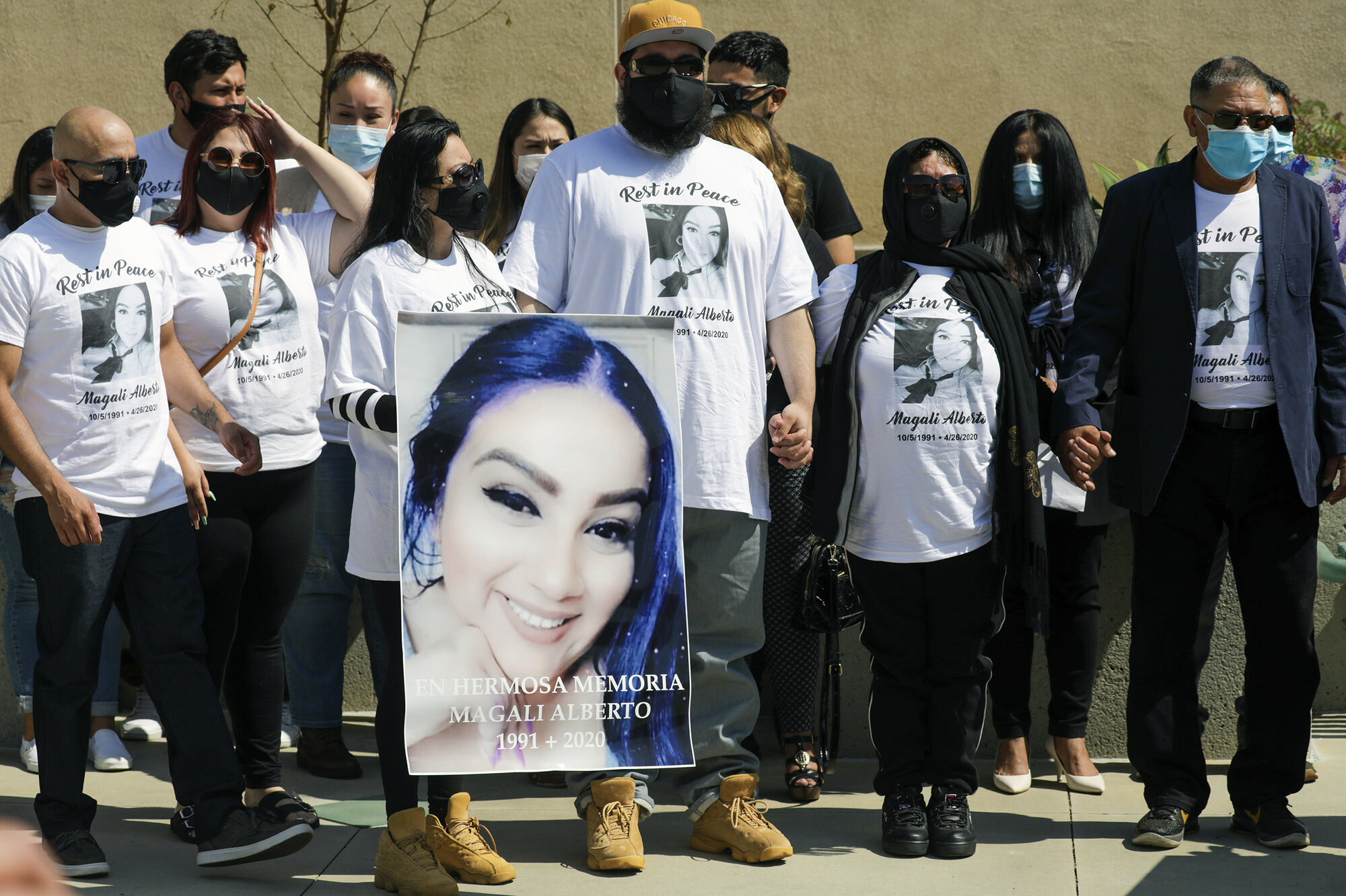 Family members of Magali Alberto, who was shot and killed at a traffic light, at a press conference held by the Los Angeles Police Department on May 28, 2020.