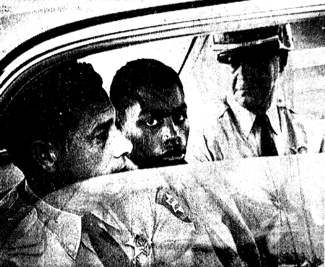 A photo from a Baton Rouge, La., newspaper shows Henry Montgomery, center, being escorted to court before his conviction for the 1963 murder of sheriff's deputy Charles Hurt.