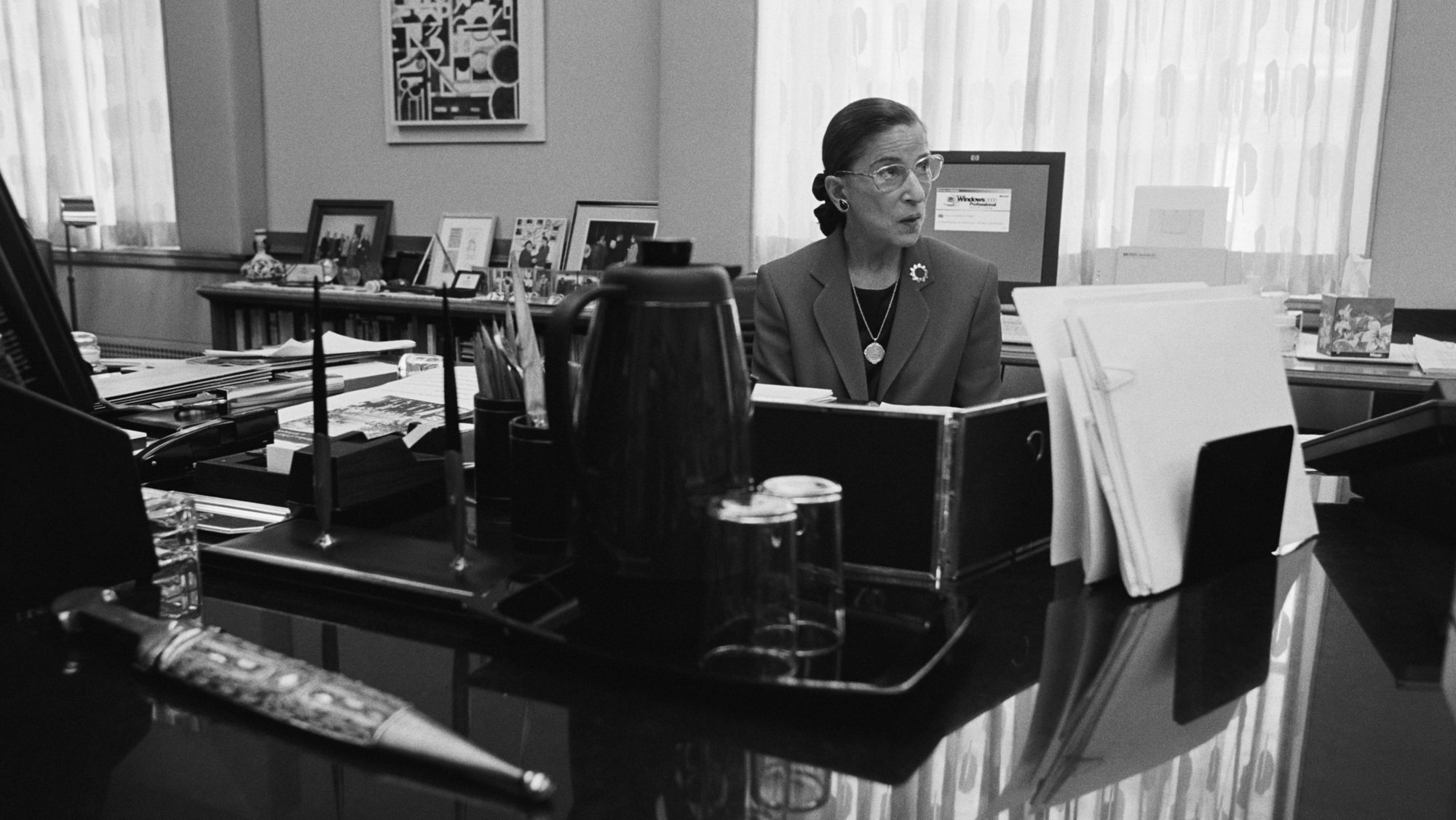 Supreme Court Justice Ruth Bader Ginsburg sits in her chambers in 2002 in Washington, DC.