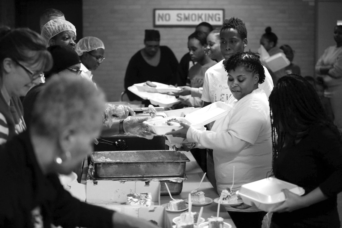 Karena Edwards, center, and her daughter being served lunch.