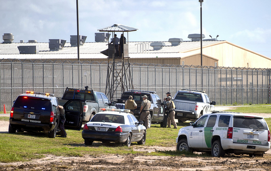 Law enforcement officials outside the Willacy County Correctional Center in Raymondville, Texas on Feb. 20.