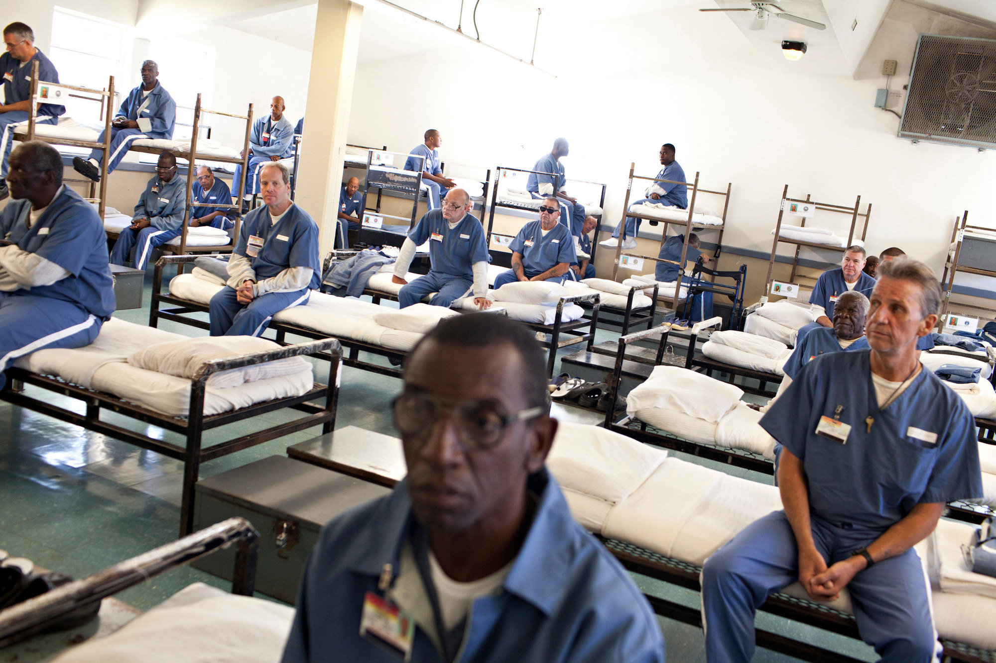 Prisoners wait for a morning head count at the Sumter Correctional Institution in Bushnell, Fla.