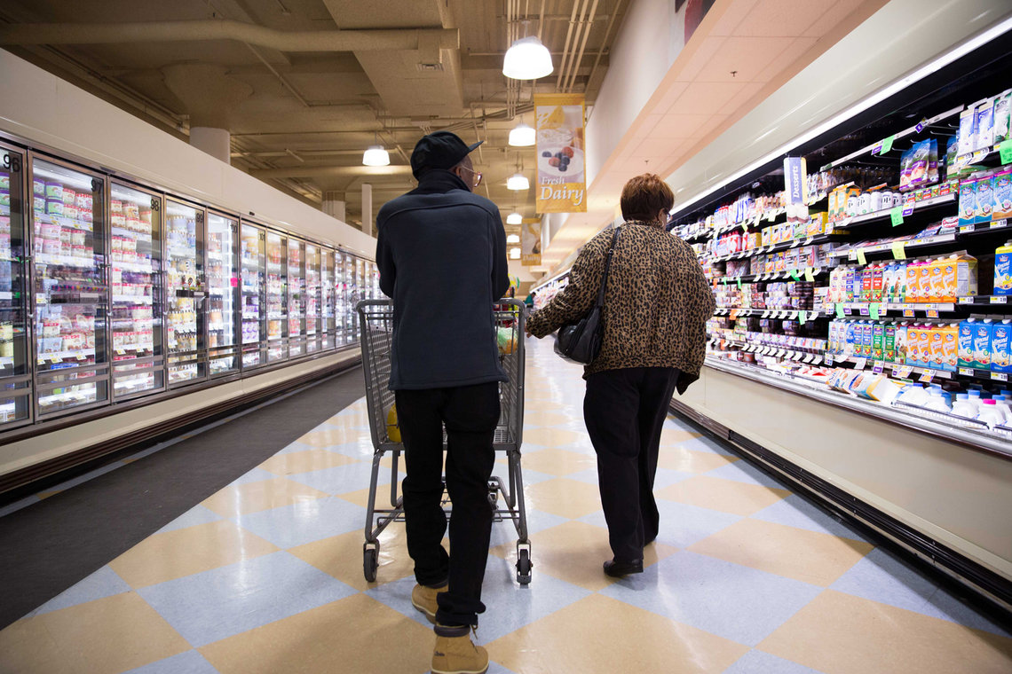Elston and his mother go grocery shopping, a day after his release from prison.