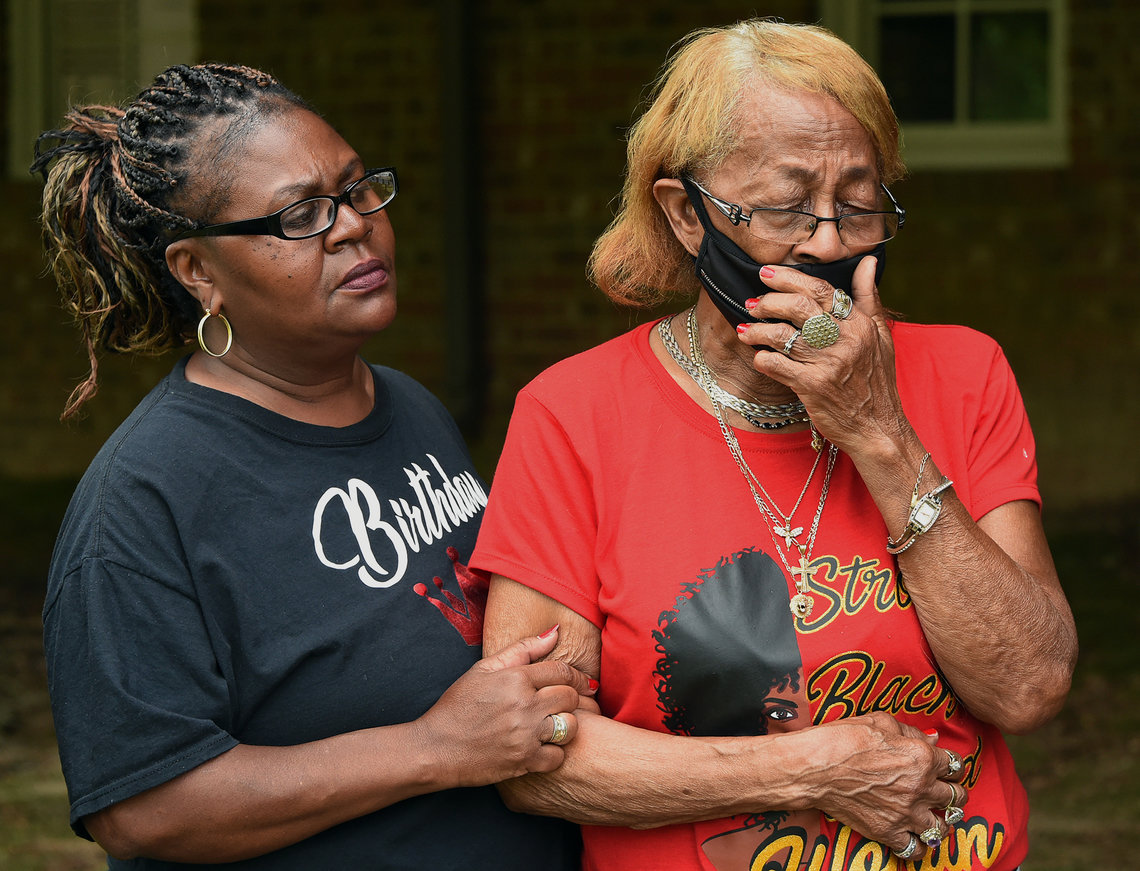 Joseph Pettaway's sister, Jacqueline, comforts their mother, Lizzie Mae Pettaway. Joseph died in July of 2018 in Montgomery, Alabama, after being bitten by a police dog.