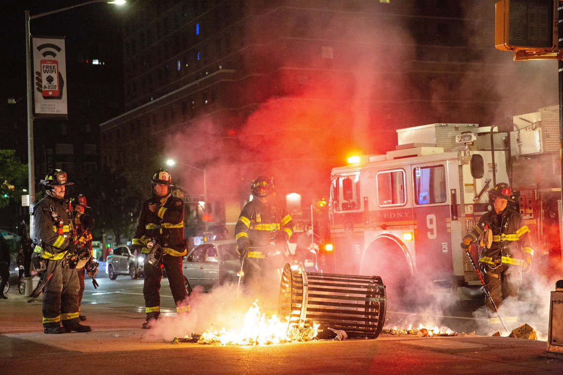 Firefighters put out a trash fire in Greenwich Village during protests on Sunday evening.