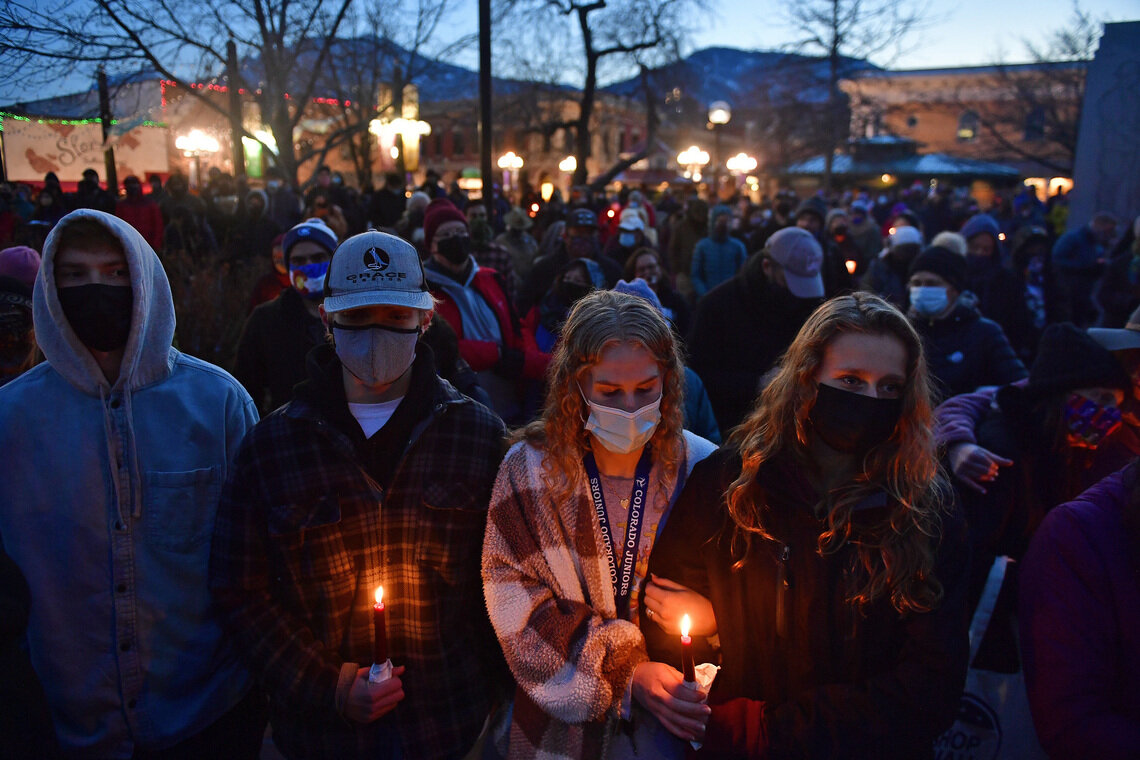 A candlelight vigil honored the 10 victims of the mass shooting at the King Soopers grocery store in Boulder, Colo., on March 24, 2021.