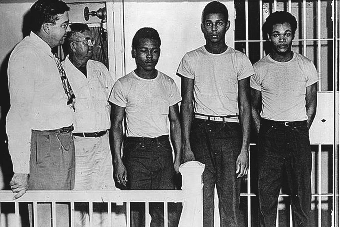 From left, Sheriff Willis McCall, jailer Reuben Hatcher, Walter Irvin, Charles Greenlee and Samuel Shepherd, at the Lake County Jail in 1949.