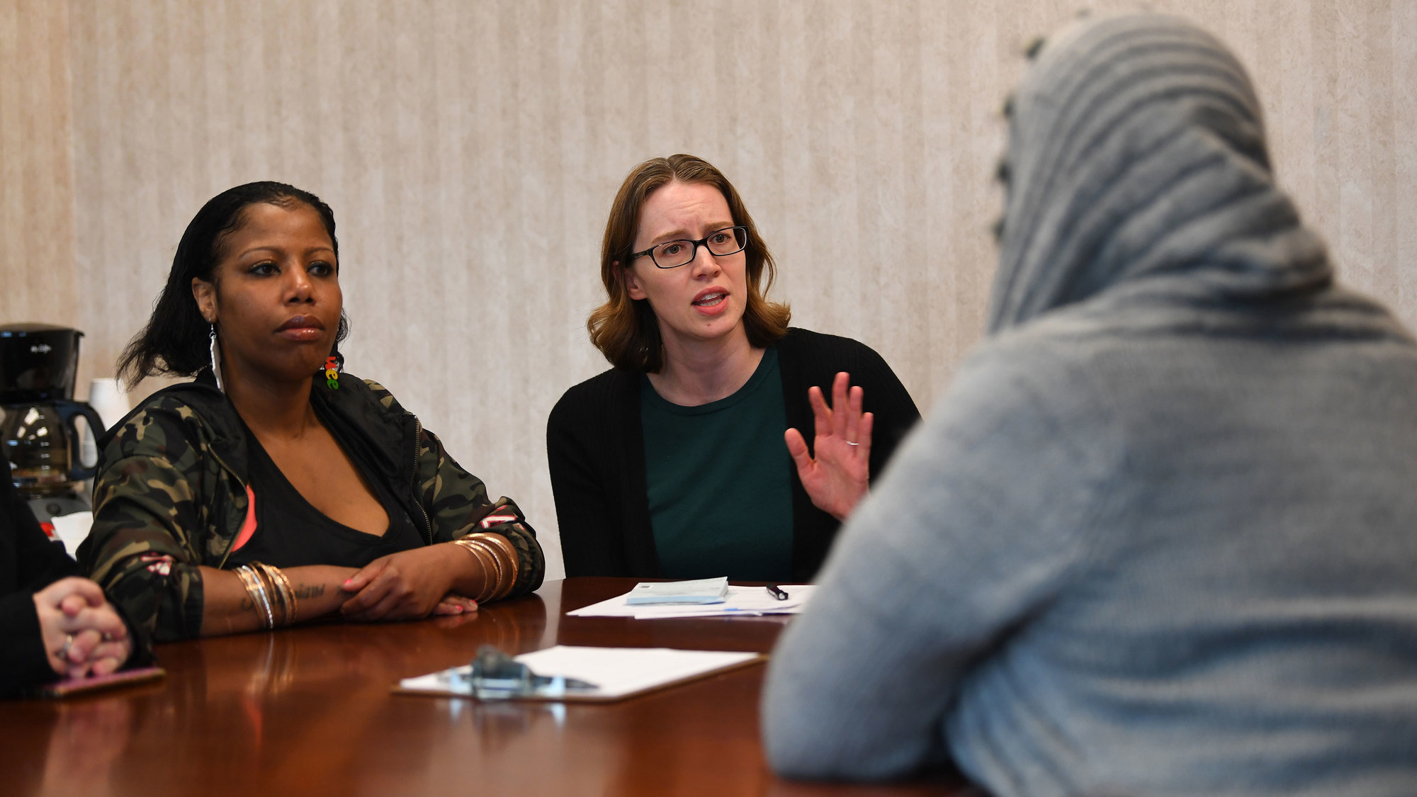 Dr. Erin Zerbo, center, who runs the Newark, N.J., CARE Center (Center for Addiction Resources & Education), talks with a group of patients, including Cydiaa Williams, at left.