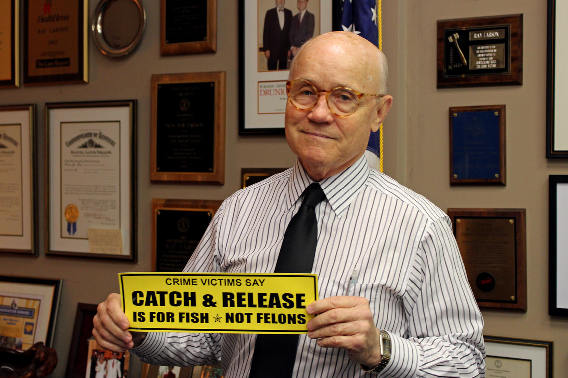 Fayette County's prosecutor, Ray Larson, with a bumper sticker he created in response to recent penal reform laws in Kentucky.