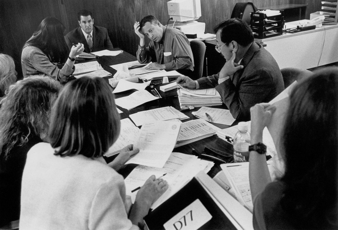 Judge Eugene Michael Heyman plans the calendar for the juvenile justice division with district attorneys, public defenders, a social worker, and a parole officer. (San Jose, 1999)