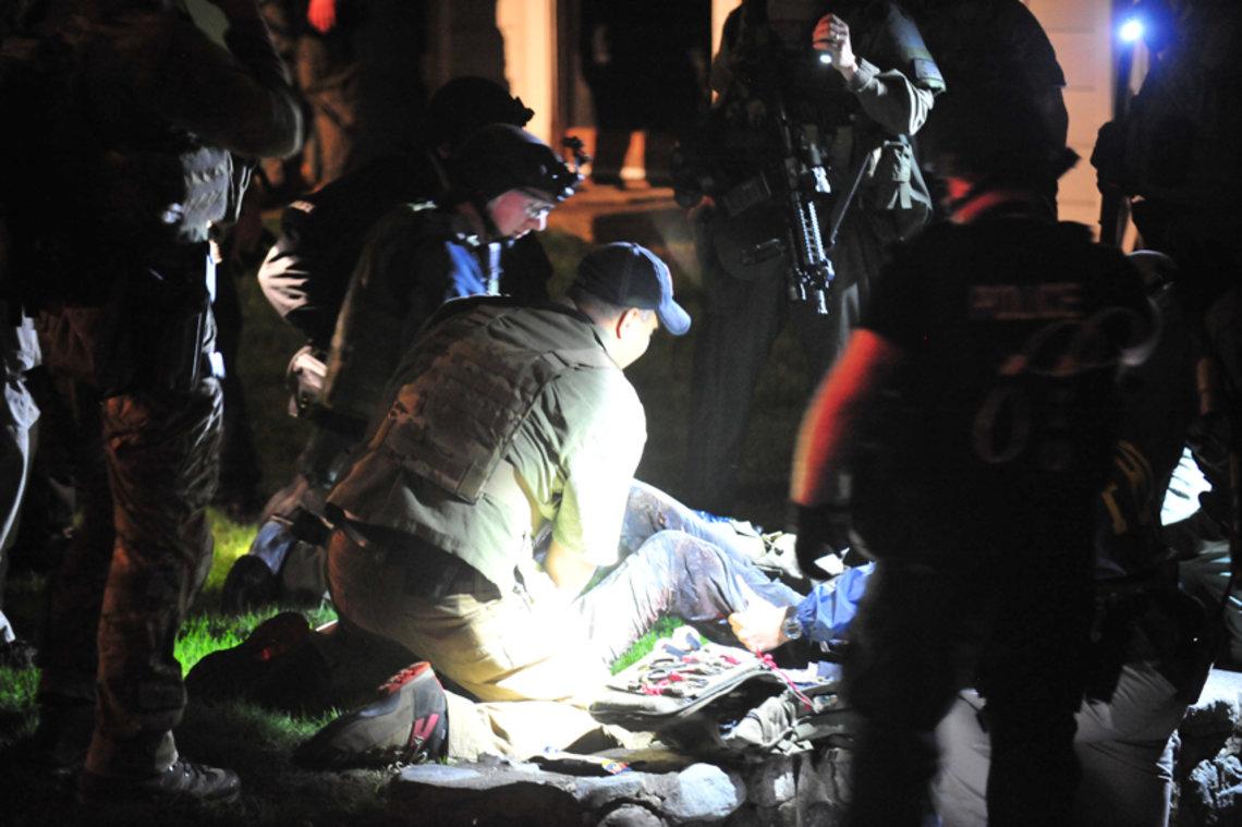 Dzhokhar Tsarnaev, surrounded by police, on April 19, 2013.