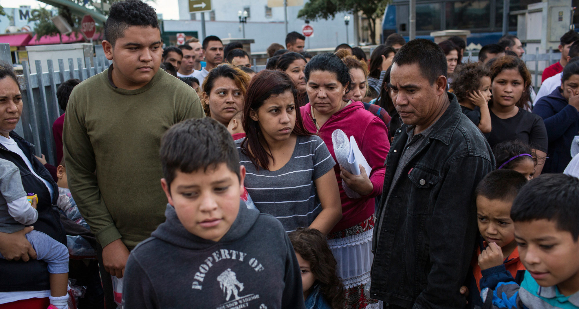 Recent undocumented border crossers arrive at a bus station in McAllen, Texas, after they were processed and released by U.S. Customs and Border Protection.