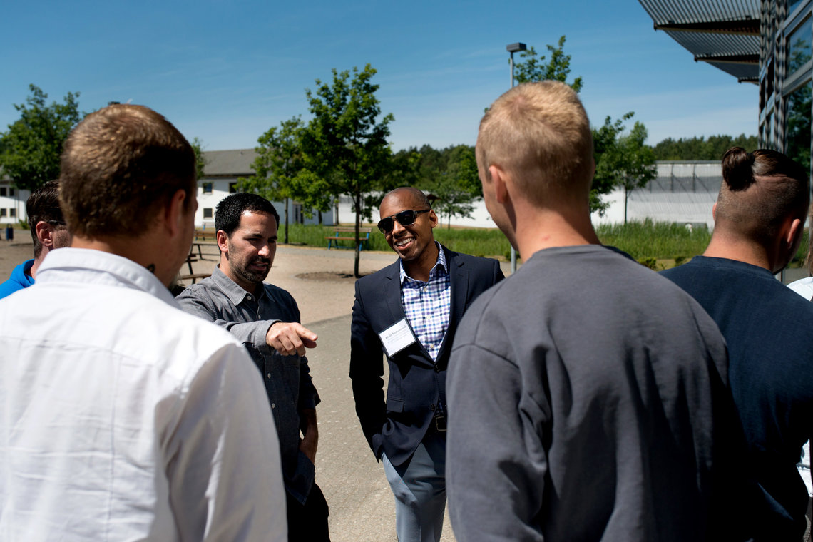 Scott Budnick, left, President of the Anti-Recidivism Coalition, and Khalil Gibran Muhammad, right, Director at Schomburg Center for Research in Black Culture in Harlem, Center talking to inmates at Neustrelitz Prison on Wednesday.