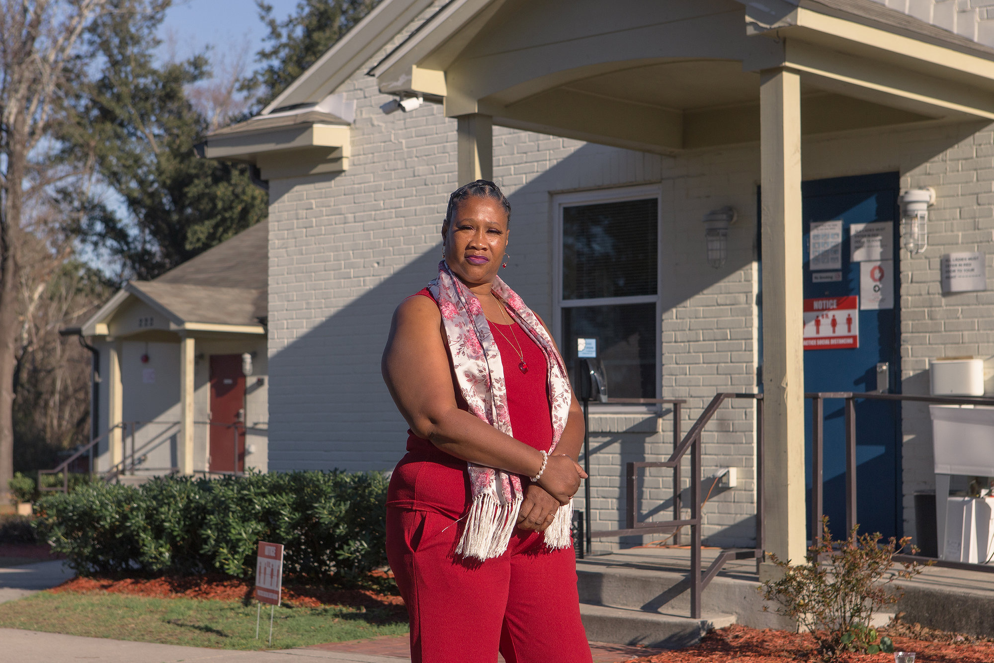 Nacola McNeil in front of the Leading Into New Communities (LINC) transitional housing in Wilmington, NC, in January.