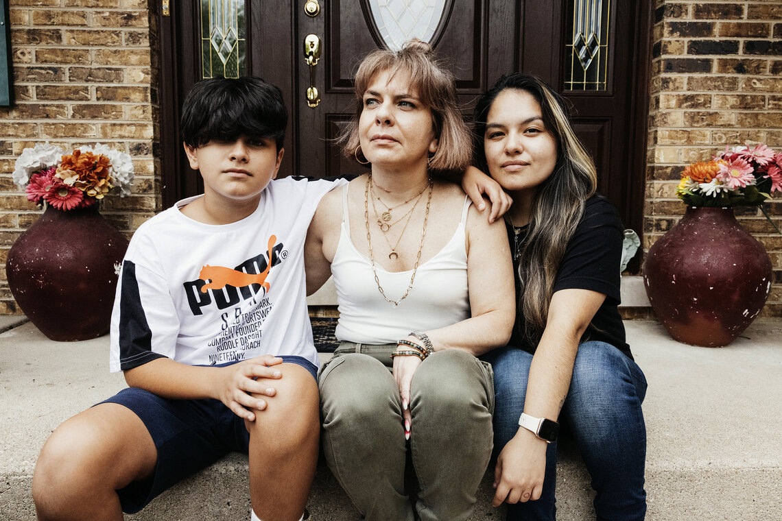 Maria Paz Perez and her children, Isabella and Xavier, outside their house. After her husband, Brigido Isidro Acosta, was deported in 2013, the family lost their home and had to move in with Maria's parents.