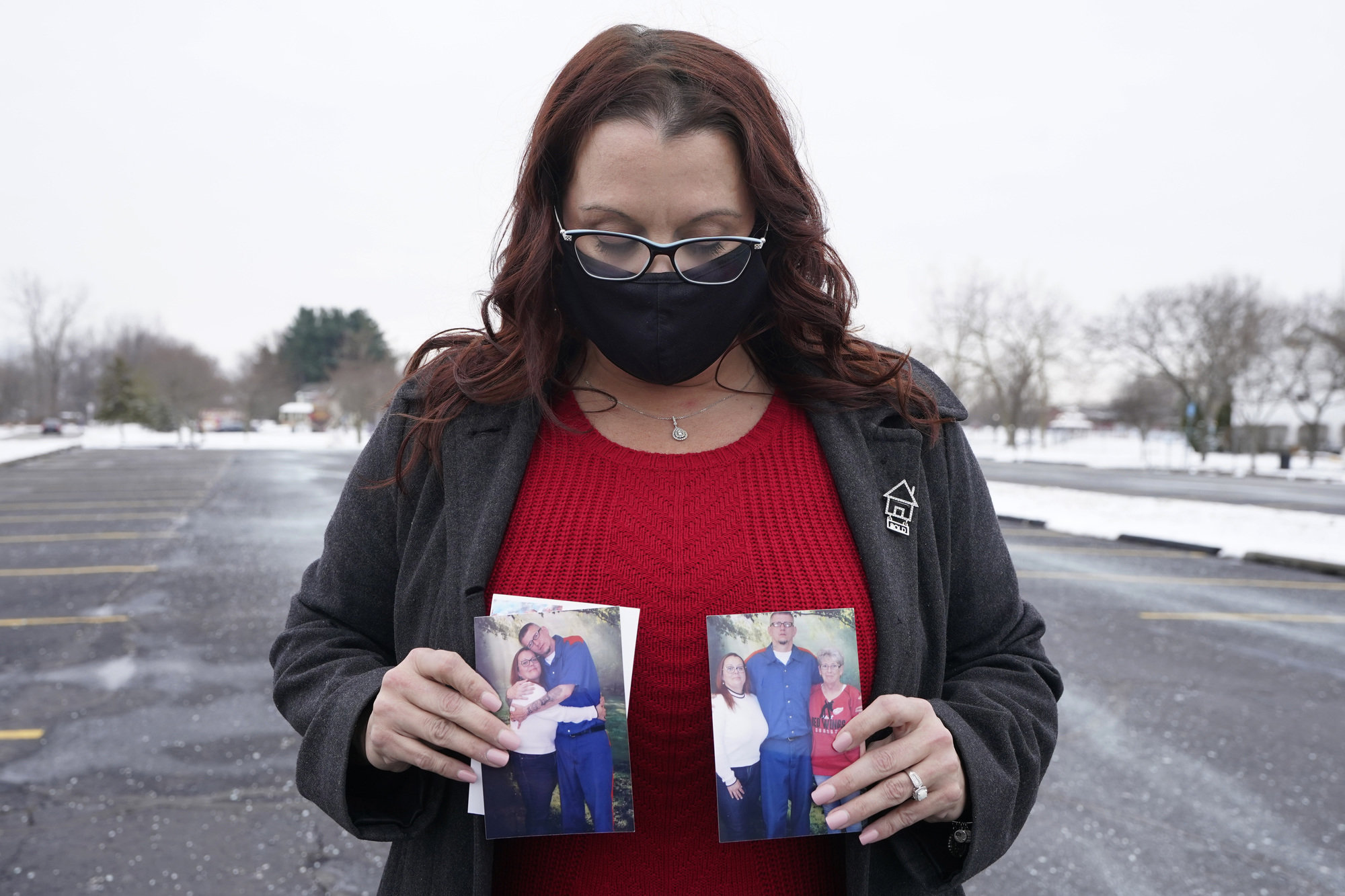 Jennifer Gross holds photos of herself with fiancé Robert Vermett, who is incarcerated at Michigan's Kinross Correctional Facility and recovering from COVID-19.