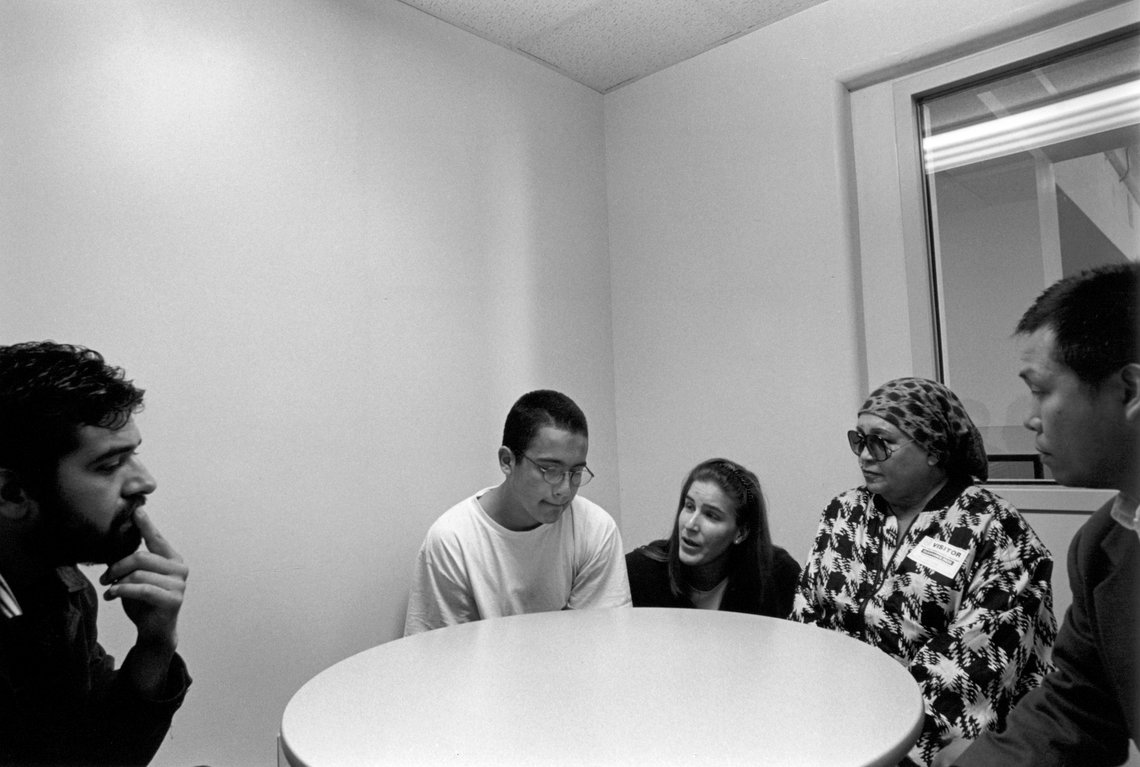 Jose meets with his public defender, grandmother, probation officer, and mental health worker before appearing in court.  (San Jose, 1999)
