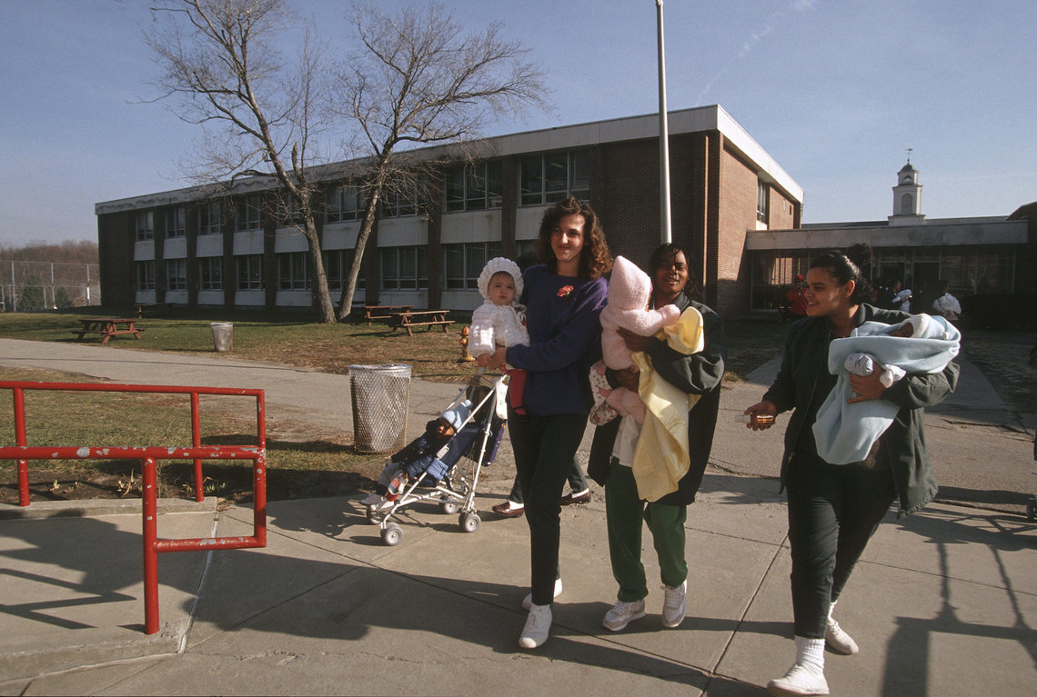Mothers returning from the parenting center at the facility.