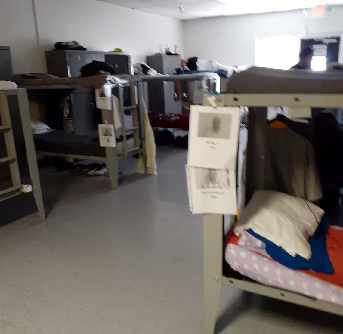 Residents sleep in double-bunks spaced a few feet apart in Orion House, where social distancing is virtually impossible.