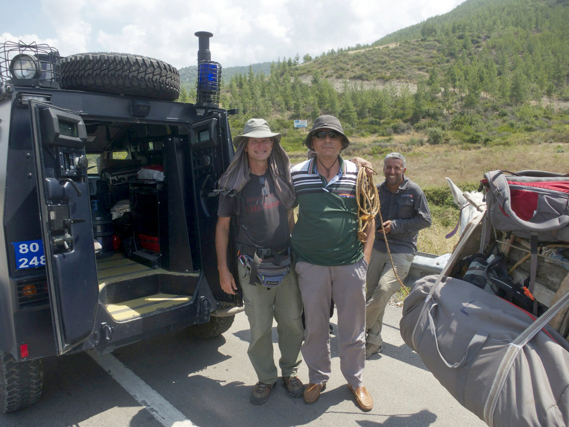 Paul Salopek, left, with an anti-terrorist police officer after being stopped with his guide, Deniz Kilic, right, on the outskirts of Osmaniye, Turkey.